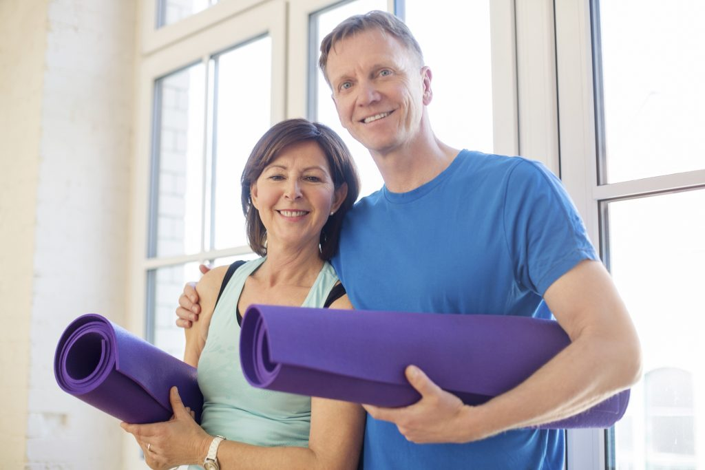 Couple enjoying gym membership