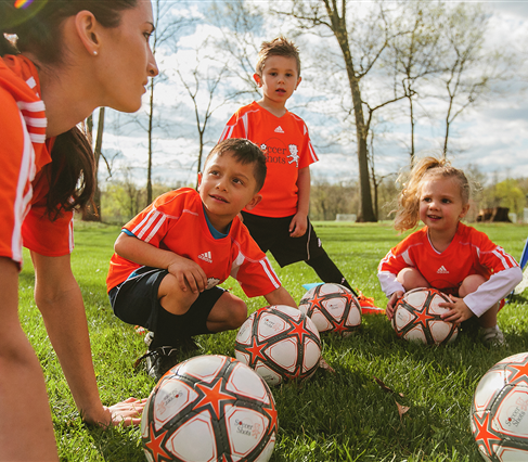 Young Kids Playing Soccer in Soccer Shots Program