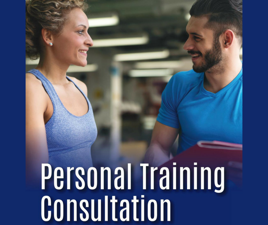 male personal trainer smiling and talking to girl