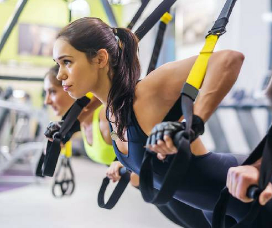 Girl using TRX Straps during Small Group Personal Training