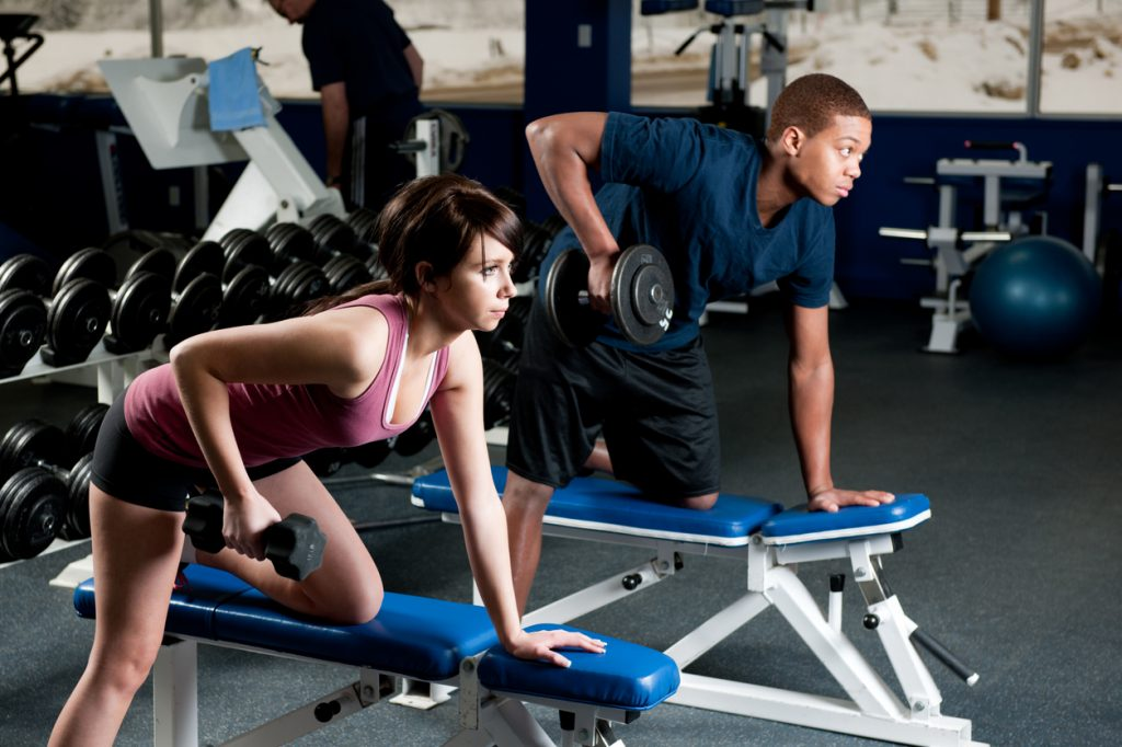 Young Teens Lifting Weights in Youth Strength Training Session