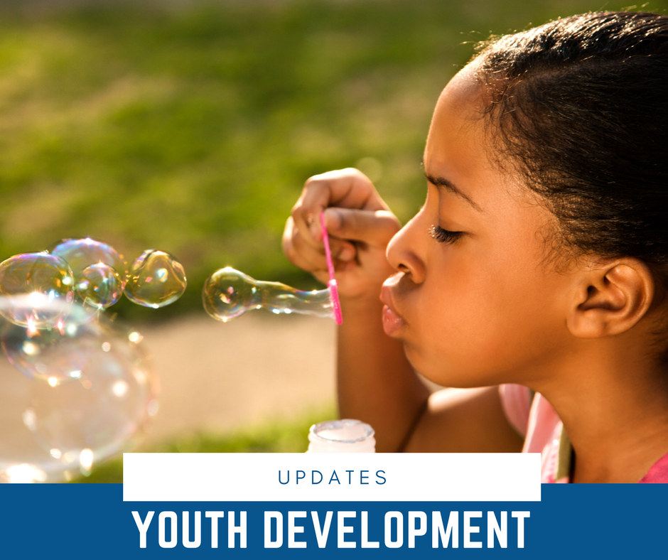 FSHFC Youth Development Updates - girl blowing bubbles outside